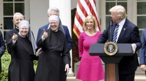 U.S President Donald Trump flanked by religious leaders speaks during a National Day of Prayer Event in the Rose Garden of the White House in Washington, DC, on May 4, 2017. Photo by Olivier Douliery/ Abaca(Sipa via AP Images)
